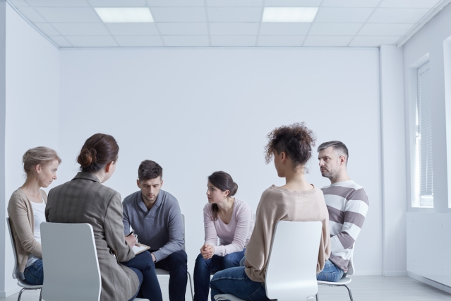 People participtaing in group psychotherapy